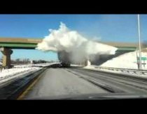 Snow Explodes As Truck Passes Under Bridge
