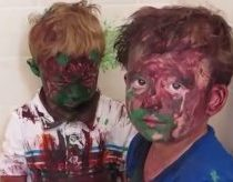 Kids play with paint a get it all over their faces