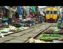 Train Runs Through Bangkok Market
