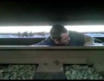 MAN UNDER MOVING TRAIN
