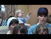 Little girl dramatically manages choir