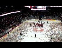 Watch 23096 stuffed animals bombard a hockey rink