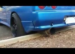 Skyline R32 driver rips exhaust off on gutter