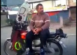 No hands, sideways fool on motorcycle