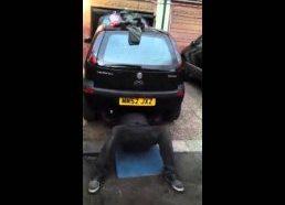 Dude Bench Presses Car