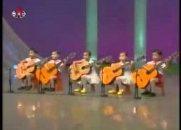 North Korea children playing the guitar. Creepy as hell.