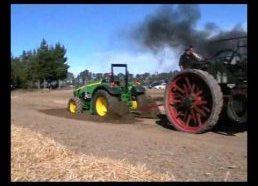 John Deere traktorius prieš 1800-ūjų garo traktorų